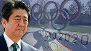 Japans Premierminister Shinzo Abe vor einem Olympia-Logo (Fotomontage) © picture alliance / SVEN SIMON
