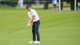 Der Norwegische Golfspieler Viktor Hovland auf dem green.