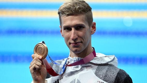 Der Bronzegewinner bei den Olympischen Spielen 2020 in Tokio Florian Wellbrock aus Deutschland © dpa +++ dpa-Bildfunk Foto:  Swen Pförtner