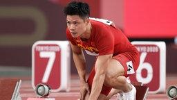 Bingtian Su aus China vor dem 100m Lauf.