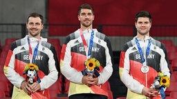 Deutschland gewinnt mit Timo Boll(l-r), Patrick Franziska und Dimitrij Ovtcharov Silber