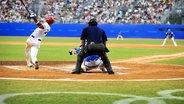 Spielszene aus dem Olympia-Finale im Baseball 2008 in Peking. Südkorea gewann Gold, Kuba Silber. © picture alliance / Xinhua Foto: Guo Lei